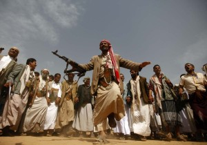 A tribesman, loyal to the al-Houthi Shi'ite rebel group, performs a traditional dance at a tribal gathering in Saada