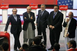 Afghan presidential candidates wait before the first presidential election debate at a local TV channel studio in Kabul