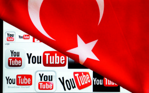 YouTube logos displayed on a laptop screen partially covered with Turkey's national flag in this photo illustration taken in Ankara