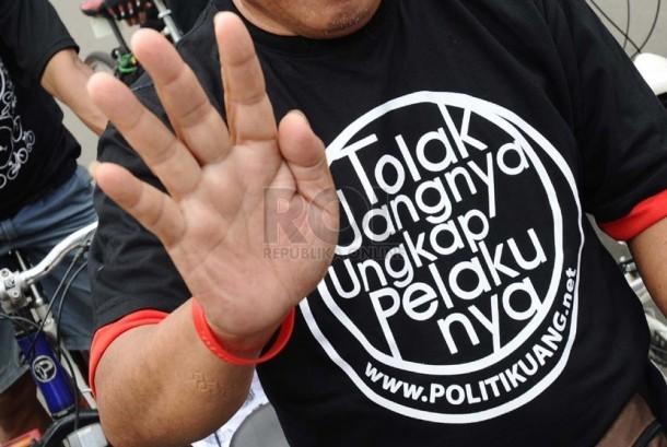 pegiat-pemilu-bersih-melakukan-aksi-kampanye-tolak-politik-uang-_140223130906-310