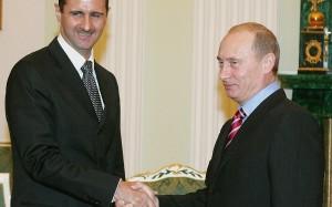 Russia's President Vladimir Putin (R) an