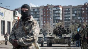 Man stands near tank in Slavyansk, Ukraine