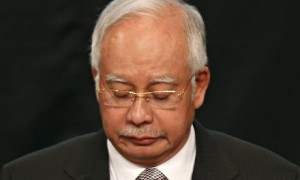 Malaysian prime minister Najib Razak announces that MH370 ended its journey in the Indian Ocean