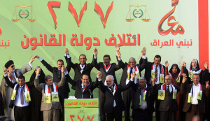 Maliki takes part in a ceremony in Kerbala