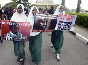 "School pupils hold signs as members of Lagos based civil society groups hold rally calling for the release of missing Chibok school girls at the state government house, in Lagos, Nigeria, on May 5, 2014. Boko Haram on Monday claimed the abduction of hundreds of schoolgirls in northern Nigeria that has triggered international outrage, threatening to sell them as ""slaves"". ""I abducted your girls,"" the Islamist group's leader Abubakar Shekau said in the 57-minute video obtained by AFP, referring to the 276 students kidnapped from their boarding school in Chibok, Borno state, three weeks ago. AFP PHOTO / PIUS UTOMI EKPEIPIUS UTOMI EKPEI/AFP/Getty Images"