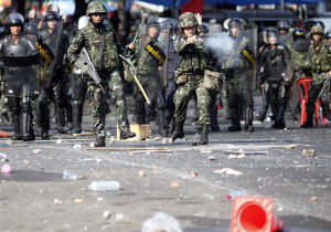 "Thai soldiers fire their weapons at anti-government ""red shirt"" protesters during clashes in central Bangkok"