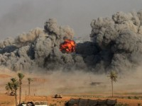 A fire ball and smoke is seen during an Israeli strike on Gaza City early on July 26, 2014.