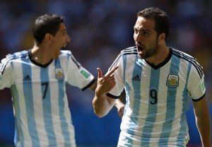 Argentina's Higuain celebrates next to Di Maria after scoring a goal against Belgium during their 2014 World Cup quarter-finals in Brasilia