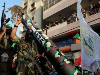 Hamas forces display an M-75 home-made rocket in a military parade in Gaza City on November, 14, 2013. Press TV