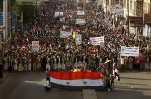 Protesters march during a demonstration against potential strikes on the Syrian government, in Sanaa