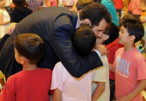 President Assad, his wife Asma greet children of martyrs: Photos