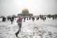 People play in the snow in front of the Dome of the Rock inside the Al-Aqsa Mosque compound in Jerusalem's Old City on January 10, 2013. Photo by Sliman Khader/Flash90 *** Local Caption *** ùìâ éìãéí ëãåø ùìâ îùç÷éí áùìâ îñâã