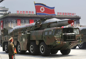 A missile is carried by a military vehicle during a parade in Pyongyang
