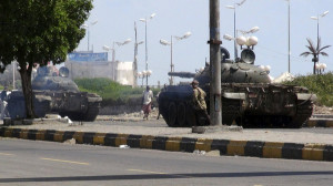 Army tanks are deployed during clashes in Aden
