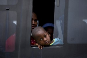 A child from Zimbabwe waits for a bus to depart for Harare, from a camp for those affected by anti-immigrant violence in Chatsworth, north of Durban
