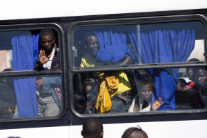 Foreigners from Malawi leave on a bus home from a camp for those affected by anti-immigrant violence in Chatsworth