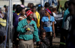 Foreign national immigrants displaced by anti-foreigner violence arrive at a temporary refugee camp in Primrose outside Johannesburg