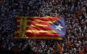 "Catalan pro-independence supporters hold a giant Catalan separatist flag during a demonstration called ""Via Lliure a la Republica Catalana"" on Catalunya's National Day in Barcelona, Spain"