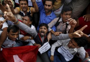 Nepalese student take part in a protest shouting anti Indian slogans near the Indian embassy in Kathmandu