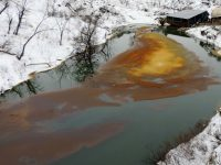 FILE - This Dec. 10, 2016, file photo, provided by the North Dakota Department of Health shows an oil spill from the Belle Fourche Pipeline that was discovered Dec. 5, 2016 in Ash Coulee Creek, a tributary of the Little Missouri River, near Belfield, N.D. Authorities say the pipeline spill is now believed to be three times larger than first estimated, and one of the biggest in state history. (Scott Stockdill/North Dakota Department of Health via AP, File)