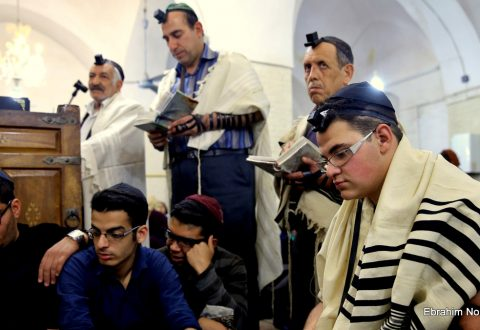 In this Thursday, Nov. 20, 2014 photo, Iranian Jews pray at the Molla Agha Baba Synagogue, in the city of Yazd 420 miles (676 kilometers) south of capital Tehran, Iran. More than a thousand people trekked across Iran this past week to visit a shrine in this ancient Persian city, a pilgrimages like many others in the Islamic Republic until you notice men there wearing yarmulkes.