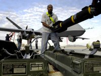 Photo of Hellfire missiles being loaded onto a US military Reaper drone in Afghanistan by Staff Sgt. Brian Ferguson/U.S. Air Force Photo of Hellfire missiles being loaded onto a US military Reaper drone in Afghanistan by Staff Sgt. Brian Ferguson/U.S. Air Force