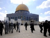 FILE - In this Friday, Oct. 5, 2012 file photo, Israeli forces take position during clashes with Palestinian worshippers at the Al-Aqsa Mosque compound in Jerusalem's Old City. A rectangular hilltop compound in Jerusalem is ground zero of the Israeli-Palestinian conflict. Known to Muslims as the Noble Sanctuary, it is Islam's third holiest spot and is home to an iconic golden-domed shrine. But to Jews it is the Temple Mount, their holiest place. This sensitive arrangement, and attempts to change it, lie at the heart of the unrest that rocked Jerusalem this week. (AP Photo/Mahmoud Illean, File)