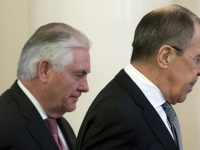CORRECTS DATE - US Secretary of State Rex Tillerson, left, and Russian Foreign Minister Sergey Lavrov walk prior to their talks in Moscow, Russia, Wednesday, April 12, 2017. Tillerson's Moscow talks hinge on new US leverage over Syria. (AP Photo/Alexander Zemlianichenko)