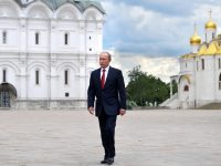 Russian President Vladimir Putin walks along the Cathedral Square of the Kremlin, to take part in a holiday reception in Moscow, Monday, June 12, 2017.  Since 1992 the 'Day of Russia' is annually celebrated on 12 June as the Russian Federation's national holiday.(Alexei Druzhinin/Sputnik, Kremlin Pool Photo via AP)