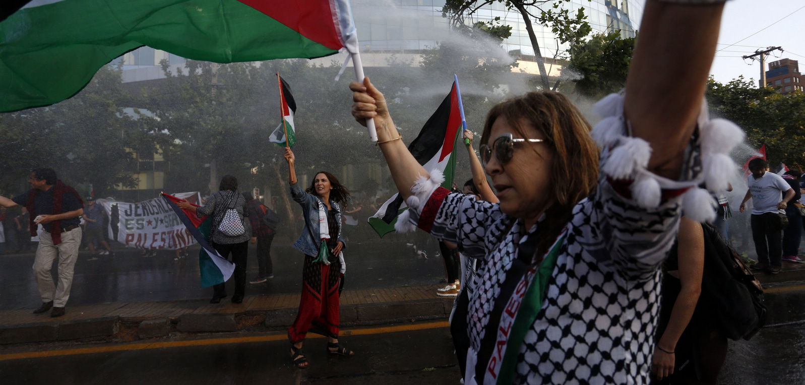 People protest U.S. President Donald Trump's decision to recognize Jerusalem as Israel's capital, outside the U.S. Embassy in Santiago, Chile, Monday, Dec. 11, 2017. The protest was organized by the Palestinian community in Chile. (AP Photo/Luis Hidalgo)