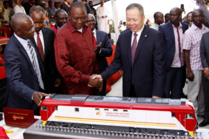 Kenyan President Uhuru Kenyatta 2nd left, and  Chen Fenjian president of CCC shaking hands next to a model of a locomotive in Mombasa, Kenya, Tuesday, May 30, 2017.  The president opened the country's largest infrastructure project since independence, a Chinese-backed railway costing nearly $3.3 billion that eventually will link a large part of East Africa to a major port on the Indian Ocean as China seeks to increase trade and influence. (AP Photo/Khalil Senosi)
