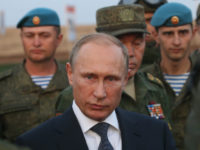 ORENBURG, RUSSIA- SEPTEMBER 19: Russian President Vladimir Putin talks to officers as he attends Russias large-scale Center-2015 military exercises at Donguzsky Range September 19, 2015 in Orenburg, Russia, The exercises, aim to contain the outbreak of an armed conflict in Central Asia. Putin said this week that it's impossible to defeat Islamic State group without support of the government of Syria and that Moscow has provided military assistance to President Bashar al-Assad's regime and will continue to do so. (Photo by Sasha Mordovets/Getty Images)