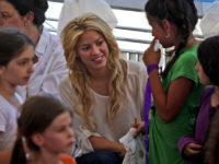 Colombian singer Shakira, center, visits a school in Jerusalem, Tuesday, June 21, 2011. Shakira is attending the Presidential Conference, sponsored by Israeli President Shimon Peres and will take part in panel alongside comedian Sarah Silverman. (AP Photo/Tara Todras-Whitehill)