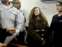 FILE - In this Monday, Jan. 15, 2018 file photo, Ahed Tamimi is brought to a courtroom inside the Ofer military prison near Jerusalem. In a Wednesday, Jan. 17, 2018 ruling an Israeli military court denied bail for the 16-year-old Palestinian girl, ordering her held until her trial on charges that she slapped and pushed two Israeli soldiers. (AP Photo/Mahmoud Illean, File)