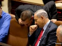 Israeli Prime Minister Benjamin Netanyahu, second right, speaks with ministers prior to a vote at the Knesset, Israel's parliament in Jerusalem, Wednesday, Dec. 3, 2014. Israeli lawmakers voted Wednesday to dissolve the Knesset, a preliminary step that will pave the way for early elections two years ahead of schedule.