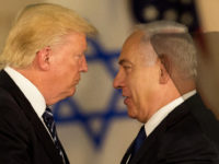 "US President Donald Trump and Israeli Prime Minister Benjamin Netanyahu embrace at the Israel museum in Jerusalem, Tuesday, May 23, 2017. President Donald Trump on Tuesday pushed for elusive peace between Israel and the Palestinians, calling on both sides to put aside the ""pain and disagreements of the past."" (AP Photo/Sebastian Scheiner)"