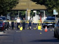 Authorities walk among evidence markers at the scene of a mass shooting, Sunday, Aug. 4, 2019, in Dayton, Ohio. Severral people in Ohio have been killed in the second mass shooting in the U.S. in less than 24 hours, and the suspected shooter is also deceased, police said. (AP Photo/John Minchillo)